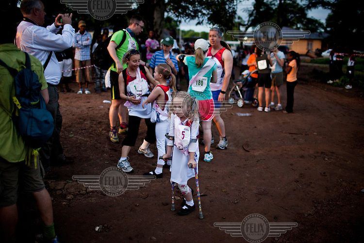 The Hope family prepare for the Marathon in Makeni at Dawn.