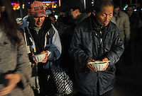 Homeless collect food donated by a charitable group in Shinjuku Park, central Tokyo  15 February 2009.   The numbers of homeless has sky-rocketed in recent months.  According charity groups who distribute food and blankets, numbers have increased by 80% in many central Tokyo parks as people have lost hundreds of thousands of jobs since the financial crisis that started in earnest year in November 2008.
