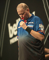 09.04.2015. Sheffield, England. Betway Premier League Darts. Matchday 10.  Raymond van Barneveld [NED] kisses his darts after a finishing double reacts during his game with Phil Taylor [ENG]