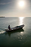 BELIZE, Caye Caulker, a fisherman on the water at the end of the day