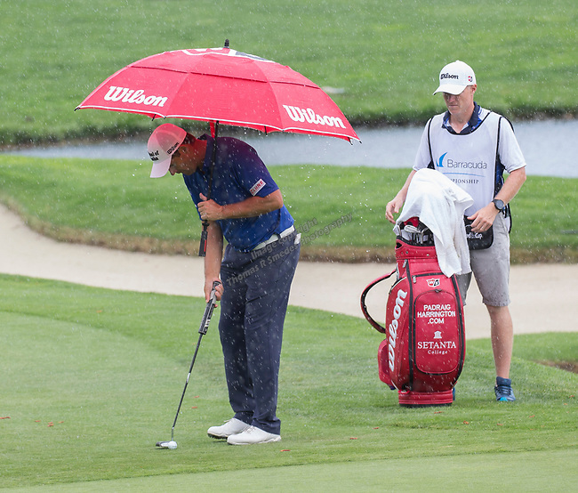 Padraig Harrington lines up a puut in the rain during the Barracuda Championship PGA golf tournament at Montrêux Golf and Country Club in Reno, Nevada on Friday, July 26, 2019.