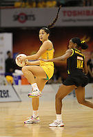 09.07.2011 Australia's Mo'onia Gerrard in action during the netball match between Jamaica and Australia at the Mission Foods World Netball Championship 2011 held at the Singapore Indoor Stadium in Singapore . Mandatory Photo Credit ©Michael Bradley.