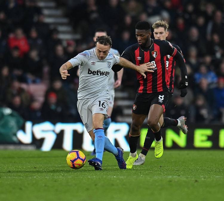 West Ham United's Mark Noble (left)  under pressure from Bournemouth's Jefferson Lerma (right) <br /> <br /> Photographer David Horton/CameraSport<br /> <br /> The Premier League - Bournemouth v West Ham United - Saturday 19 January 2019 - Vitality Stadium - Bournemouth<br /> <br /> World Copyright &copy; 2019 CameraSport. All rights reserved. 43 Linden Ave. Countesthorpe. Leicester. England. LE8 5PG - Tel: +44 (0) 116 277 4147 - admin@camerasport.com - www.camerasport.com