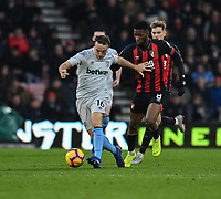 West Ham United's Mark Noble (left)  under pressure from Bournemouth's Jefferson Lerma (right) <br /> <br /> Photographer David Horton/CameraSport<br /> <br /> The Premier League - Bournemouth v West Ham United - Saturday 19 January 2019 - Vitality Stadium - Bournemouth<br /> <br /> World Copyright © 2019 CameraSport. All rights reserved. 43 Linden Ave. Countesthorpe. Leicester. England. LE8 5PG - Tel: +44 (0) 116 277 4147 - admin@camerasport.com - www.camerasport.com