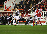 Jim Goodwin shoots before being closed down by Josh Magennis in the Aberdeen v St Mirren Scottish Communities League Cup match played at Pittodrie Stadium, Aberdeen on 30.10.12.
