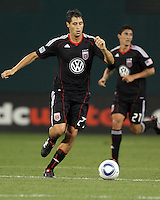 Branko Boskovic #27 of D.C. United with Pablo Hernandez #21 in the background during an MLS match against Seattle Sounders FC at RFK Stadium on July 15 2010, in Washington DC.Seattle won 1-0.