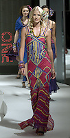 HONG KONG - JULY 7: A model walks down the runway with a creation by Indonesian designer Ika at the 'One Love' show during the Hong Kong Fashion Week S/S 2010 on July 7, 2009 in Hong Kong. Photo by Victor Fraile / studioEAST