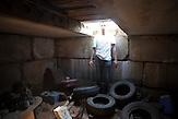 """Denis Malofejew war bis zu seiner Kündigung Mitarbeiter in einem Ersatzteillager. Jetzt hat er nur noch sein privates kleines Lager. Wenn der 29 jährige weiter arbeitslos bleibt, muß er vielleicht bald eine """"Arbeitslosen-Steuer"""" bezahlen. / Denis Malofeyev, ex-seller of second-hand auto parts, posses at private auto-parts storage."""