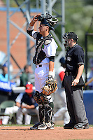 Jamestown Jammers catcher Andrew Dennis (25) and umpire Rich Grassa during a game against the Brooklyn Cyclones on August 4, 2013 at Russell Diethrick Park in Jamestown, New York.  Jamestown defeated Brooklyn 9-5.  (Mike Janes/Four Seam Images)