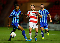 Blackpool's Joe Nuttall vies for possession with Doncaster Rovers' Alfie May<br /> <br /> Photographer Alex Dodd/CameraSport<br /> <br /> The EFL Sky Bet League One - Doncaster Rovers v Blackpool - Tuesday September 17th 2019 - Keepmoat Stadium - Doncaster<br /> <br /> World Copyright © 2019 CameraSport. All rights reserved. 43 Linden Ave. Countesthorpe. Leicester. England. LE8 5PG - Tel: +44 (0) 116 277 4147 - admin@camerasport.com - www.camerasport.com