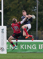 Tom Howe of Jersey & Peter Lydon of London Scottish go for the ball during the Greene King IPA Championship match between London Scottish Football Club and Jersey at Richmond Athletic Ground, Richmond, United Kingdom on 7 November 2015. Photo by Andy Rowland.
