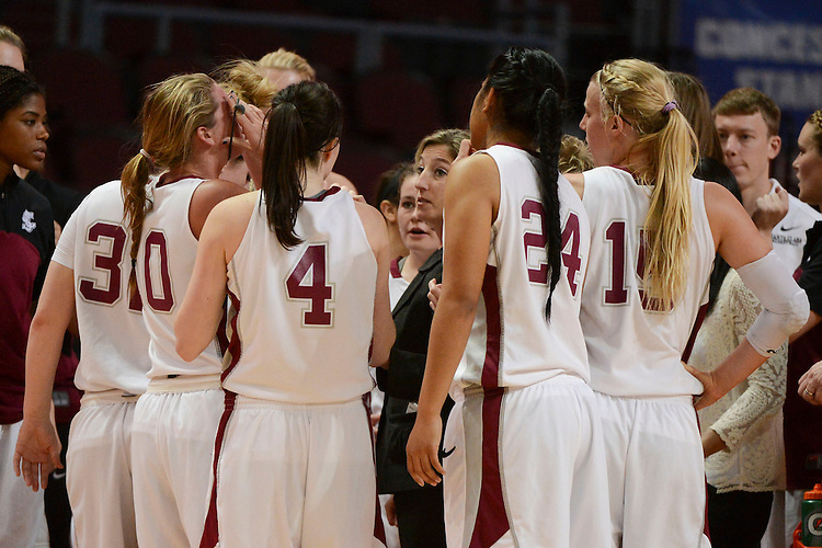 March 6, 2014; Las Vegas, NV, USA; Santa Clara Broncos head coach Jennifer Mountain instructs in a huddle against the Pepperdine Waves during the second half of the WCC Basketball Championships at Orleans Arena. The Waves defeated the Broncos 80-74.