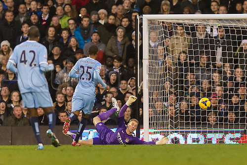 21.12.2013 London, England.  Manchester City's goalkeeper Joe HART at full stretch but the shot goes wide on this occasion during the Premier League game between Fulham and Manchester City from Craven Cottage.