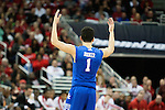 December 27, 2014- Guard Devin Booker of the Kentucky Wildcats celebrates the win during the game against  the Louisville Cardinals at KFC Yum! Center in Louisville `, Ky. Kentucky defeated Louisville 58-50. Photo by Michael Reaves | Staff