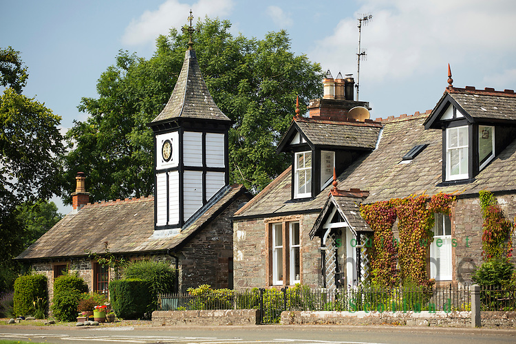 Parton Village, a terraced row of cottages<br /> with the end cottage have a small clock tower on its roof. James Clerk Maxwell, father of modern physics stayed near Parton and is buried in Parton Church
