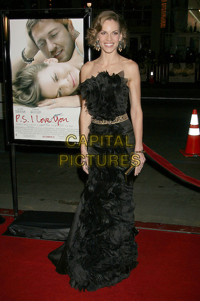 "HILARY SWANK.""P.S. I Love You"" Los Angeles Premiere at Grauman's Chinese Theatre, Hollywood, California, USA,.9 December 2007..full length black strapless ruffle front dress.CAP/ADM/RE.©Russ Elliott/AdMedia/Capital Pictures."