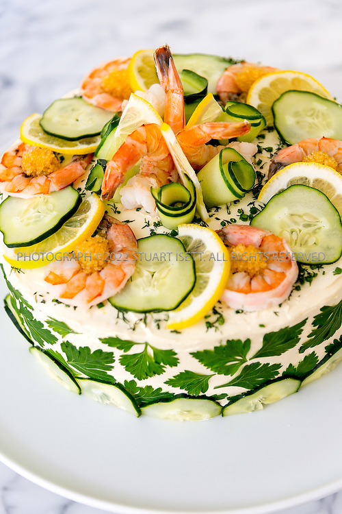 8/22/2016-- Seattle, WA, USA<br /> <br /> <br /> Sarah Gannholm, 48, serving Smorgastorta, an elaborate Swedish savory sandwich cake, to her family and some friends at her home in Seattle, Washington.<br /> <br /> <br /> Photograph by Stuart Isett. &copy;2016 Stuart Isett. All rights reserved.