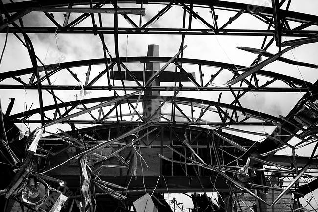 The crucifix on top of St. Mary's Catholic Church survived the storm and remains standing. Joplin, Mo. May 26, 2011...
