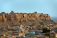 Dusk over the GOLDEN CITY of JAISALMER with JAISALMER FORT and its 99 bastions which was built in 1156 on TRIKUTA HILL - RAJASTHAN, INDIA