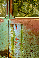Blue door and window with rust and fall leaves at Old Car City USA
