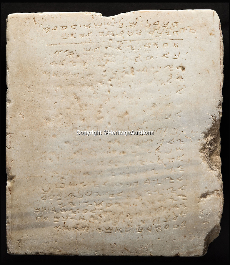 BNPS.co.uk (01202 558833)<br /> Pic: HeritageAuctions/BNPS<br /> <br /> The earliest known complete stone inscription of the Ten Commandments has been put up for sale for £500,000.<br /> <br /> The square tablet, that weighs 200lbs, is believed to date back to the fourth century and adorned an ancient synagogue in Isreal that was destroyed by the Romans between 400AD to 600AD.<br /> <br /> The 'thou shalt' commandments were chiseled into the white marble slab in 20 lines of letters in the early Hebrew script called Samaritan.<br /> <br /> The 2ft by 2ft tablet was uncovered in 1913 during excavations for a railway station near Yavneh in Isreal.<br /> <br /> The sale takes place on November 16.