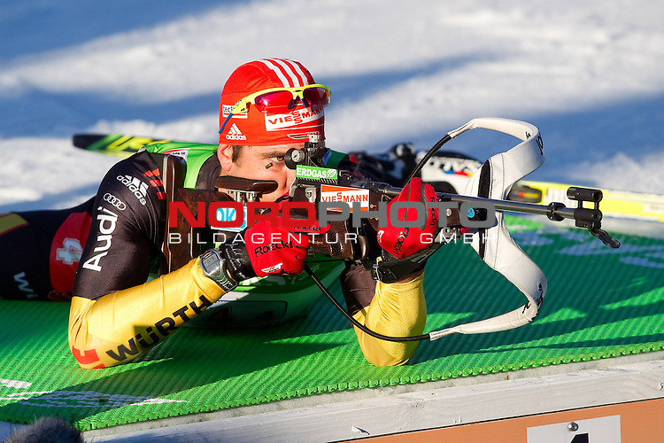 01.03.2012, Chiemgau-Arena, Ruhpolding,  GER, IBU WM 2012, Ruhpolding, Mixed 2x6+2x7.5 km Staffel,  im Bild Peiffer Arnd (GER) beim Liegendschiessen // during IBU World Championships Biathlon Ruhpolding, Mixed 2x6+2x7.5 km Relay,2012/03/01 at Chiemgau-Arena, Foto © nph / Straubmeier *** Local Caption ***