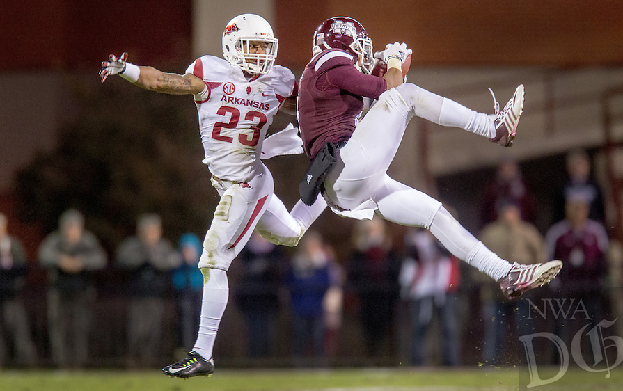 HAWGS ILLUSTRATED JASON IVESTER --11/01/2014--<br /> Arkansas senior defensive back Tevin Mitchell defends as Mississippi State sophomore wide receiver Fred Ross tries to make a catch on Saturday, Nov. 1, 2014, at Davis Wade Stadium in Starkville, Miss.
