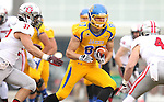 BROOKINGS, SD - NOVEMBER 22:  Jason Schneider #83 from South Dakota State University looks for room between Colin Buscarini #37 and Ryan Hillier #4 from the University of South Dakota in the first half of their game Saturday at Coughlin Alumni Stadium in Brookings. (Photo by Dave Eggen/Inertia)