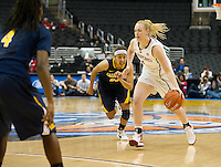 LOS ANGELES, CA - March 10, 2012: Forward Taylor Greenfield (4) of the Stanford University woman's basketball team competes against Cal during the PAC 12 Woman's Basketball Championship Game at the Staples Center in Los Angeles California. Final score Stanford won 77-62.