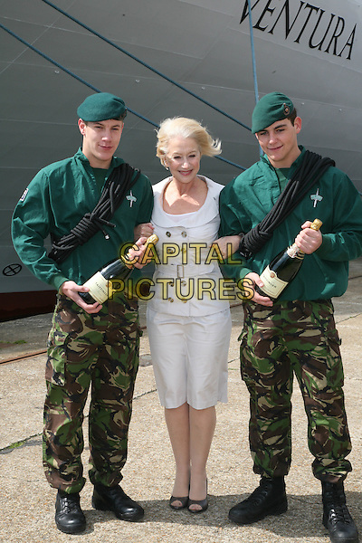 DAME HELEN MIRREN & ROYAL MARINE COMMANDOS.P&O Ventura - photocall, cruise shp naming ceremony, Southampton Dock Mayflower Cruise terminal, Southampton, England..April 16th, 2008.full length grey gray silver jacket skirt  camouflage trousers green uniform top hat champagne bottles beverage drink arms linked .CAP/DS.©Dudley Smith/Capital Pictures