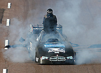 Feb 21, 2015; Chandler, AZ, USA; NHRA funny car driver Shane Westerfield climbs out of the roof hatch after suffering an engine fire during qualifying for the Carquest Nationals at Wild Horse Pass Motorsports Park. Mandatory Credit: Mark J. Rebilas-
