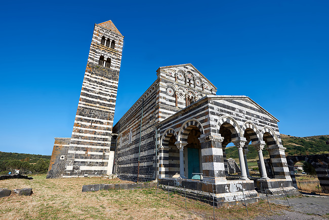 Picture and image of the exterior of the Tuscan Romanesque Pisan style basilica of Santissima Trinita di Saccargia, consecrated 1116, Codrongianos, Sardinia.