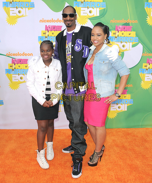 SNOOP DOGG & daughters (Cordozar Calvin Broadus) .attending The 24th Annual Kids' Choice Awards held at USC's Galen Center in Los Angeles, California, USA, .April 2nd 2011..full length children kids family jacket jeans goatee facial hair sunglasses white black collar purple  pink dress denim white  red .CAP/RKE/DVS.©DVS/RockinExposures/Capital Pictures.