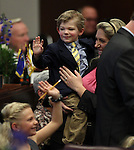 Nevada Sen. Ben Kieckhefer, R-Reno, introduces his family April Kieckhefer, son Lincoln, 3, and daughter Aspen, 6, during the opening day of the 77th Legislative Session in Carson City, Nev. on Monday, Feb. 4, 2013..Photo by Cathleen Allison