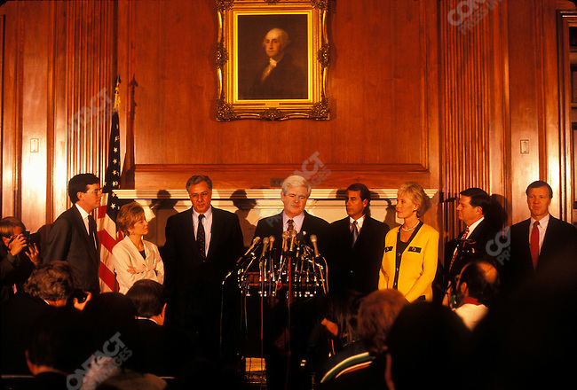 Representative John Boehner (R-Ohio, center right) and other Republican leaders with Representative Newt Gingrich (R-GA, center), as Gingrich is voted in as Speaker of the House of Representatives for a second term. Washington, D.C., January 1997