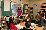 Elementary school Grade 5 female teacher at work teaching class social studies geography lesson
