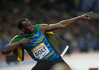 Usain BOLT of Jamaica (Men's 100m) celebrates his 100m victory during the Sainsburys Anniversary Games at the Olympic Park, London, England on 24 July 2015. Photo by Andy Rowland.