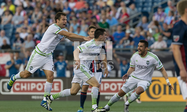 Foxborough, Massachusetts - May 28, 2016: First half action. In a Major League Soccer (MLS) match, the New England Revolution (blue/white) vs Seattle Sounders FC (white), 1-1 (halftime), at Gillette Stadium.<br /> Goal celebration.