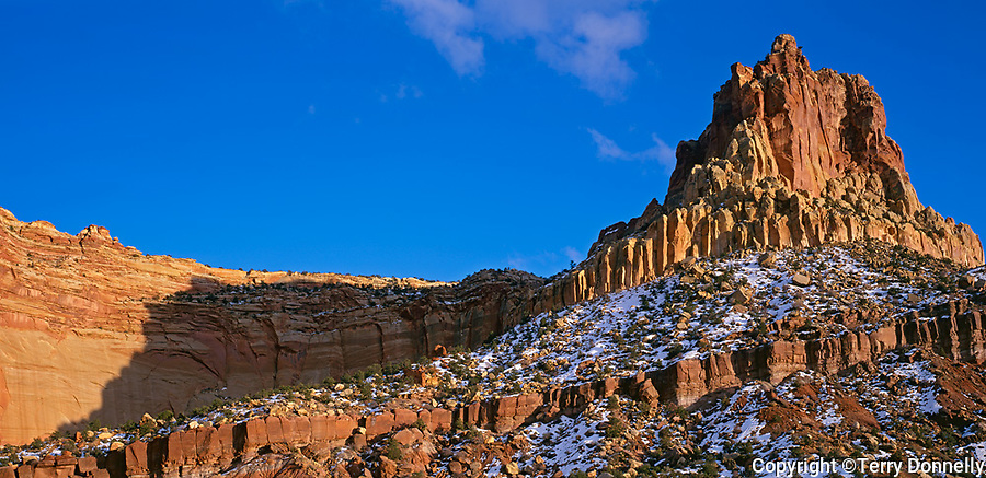 Capitol Reef National Park, UT: Eph Hanks Tower stands above Capitol Wash in evening light