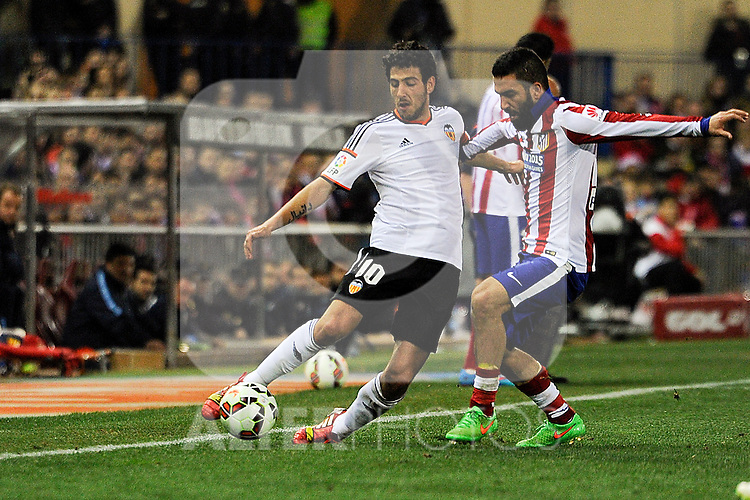 Atletico de Madrid´s Arda Turan and Valencia CF´s Daniel Parejo during 2014-15 La Liga match between Atletico de Madrid and Valencia CF at Vicente Calderon stadium in Madrid, Spain. March 08, 2015. (ALTERPHOTOS/Luis Fernandez)