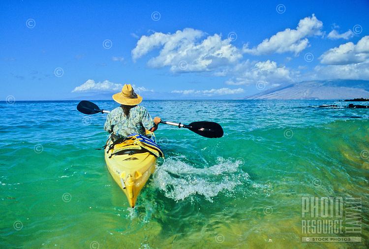Kayaker paddles into wave off Maui