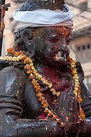 Nepal, Patan.  Garuda Shrine and Offerings of Garlands and Kumkuma (Sindoor) Powder.