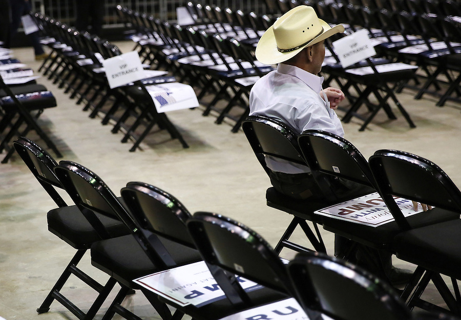A supporter of Republican U.S. presidential candidate Donald Trump rests before a rally in Baton Rouge, Louisiana February 11, 2016. REUTERS/Jonathan Bachman