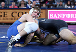 SIOUX FALLS, SD - NOVEMBER 15: Cade King from South Dakota State controls Alex Melikian from Binghamton during their 174 pound match Friday night at the Sanford Pentagon in Sioux Falls, SD. (Photo by Dave Eggen/Inertia)
