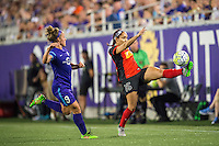 Orlando, Florida - Sunday, May 14, 2016: Western New York Flash defender Jaelene Hinkle (15) settles the ball while pressured by Orlando Pride forward Josee Belanger (9) during a National Women's Soccer League match between Orlando Pride and New York Flash at Camping World Stadium.
