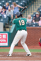Juan Avila (19) of the Greensboro Grasshoppers at bat against the Hagerstown Suns at NewBridge Bank Park on May 20, 2014 in Greensboro, North Carolina.  The Grasshoppers defeated the Suns 5-4. (Brian Westerholt/Four Seam Images)