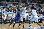 26 February 2012: Duke's Chelsea Gray (12) drives against North Carolina's Chay Shegog (20) and She'la White (1). The Duke University Blue Devils defeated the University of North Carolina Tar Heels 69-63 at Carmichael Arena in Chapel Hill, North Carolina in an NCAA Division I Women's basketball game.