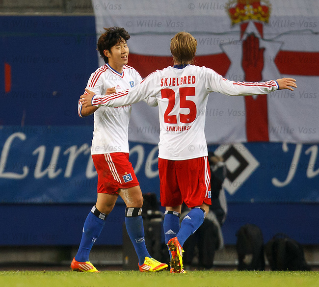 Heung Min Son ce;ebrates with Per Cijan Sklelbred