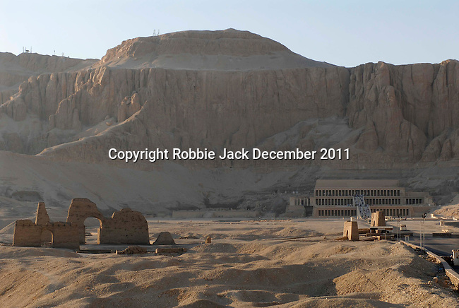 The approach to Deir el-Bahari the mortuary temple of Queen Hatshepsut at Thebes.Thebes is the name the Greeks gave to Waset, the ancient capital of Egypt.