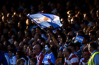 An Argentina fan in the crowd waves a flag in support. Rugby World Cup Pool C match between Argentina and Georgia on September 25, 2015 at Kingsholm Stadium in Gloucester, England. Photo by: Patrick Khachfe / Onside Images